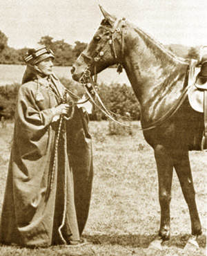 Lady Anne Blunt, in Bedouin attire, with her favourite riding mare, Kasida